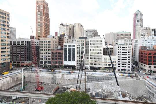 Construction continues on the Hudson's site in Detroit with foundation work and the drilling and filling of caissons for load bearing.