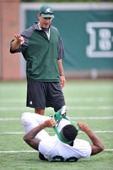 Dave Warner was moved from co-offensive coordinator to quarterbacks coach.