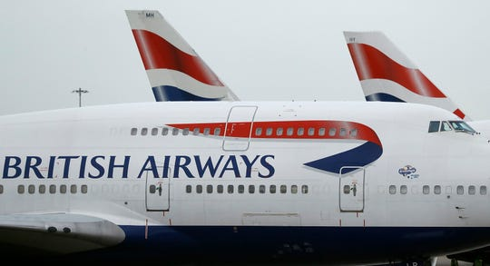 British Airways planes are parked at Heathrow Airport in London.