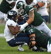 Joe Bachie (35) and Mike Panasiuk (72) are both back to help lead a Michigan State defense that ranked No. 10 nationally in total defense in last season.