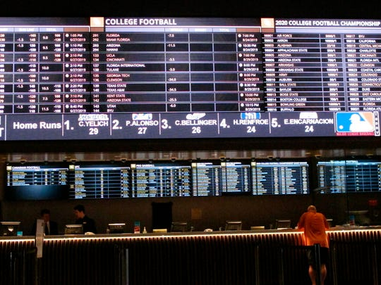A gambler places a bet at the sportsbook at Bally's casino in Atlantic City.