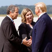 Democratic Senator Sherrod Brown, of Ohio, left, and Dayton Mayor Nan Whaley are greeted by President Trump at Wright-Patterson Air Force Base, Wednesday, Aug. 7, 2019, in Dayton, Ohio.