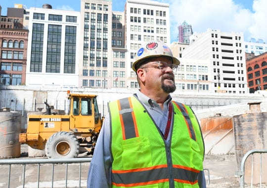 Bedrock Detroit VP of construction Joe Guziewicz leads a tour Wednesday into the Hudson's site construction in Detroit.