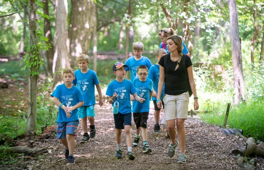 Instructor Miranda Roberts, right, takes Cub Scout Pack 135 for a hike during a STEM camp at Stage Nature Center in Troy.