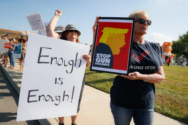 Demonstrators gather to protest the arrival of President Donald Trump outside Miami Valley Hospital after a mass shooting that occurred in the Oregon District early Sunday morning, Wednesday, Aug. 7, 2019, in Dayton, Ohio.