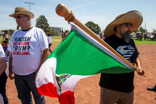 Fernando Montoya, right, waves a Mexican flag to protest the visit of President Donald Trump to the border city after the Aug. 3 mass shooting in El Paso, Texas, Wednesday, Aug. 7, 2019.