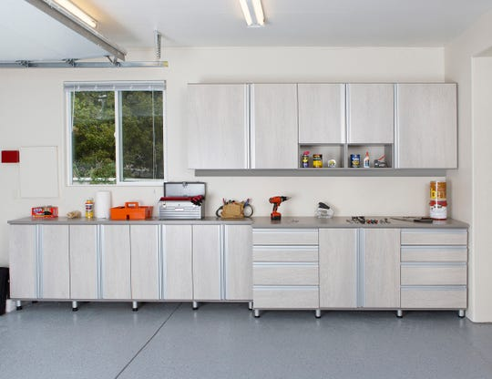 A closed storage cabinet system with multiple drawers makes it easy to roll-out in an organized way. Lots of countertop gives the space for multiple projects, while storage cabinetry has adjustable shelving for changing needs.