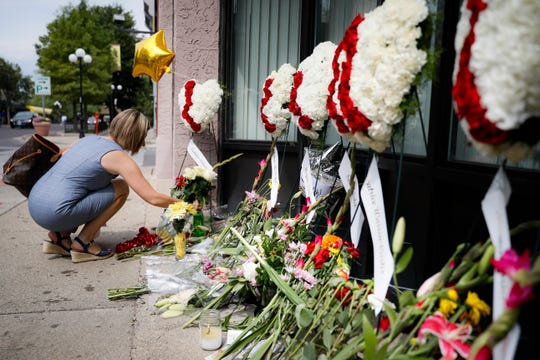 Mourners bring flowers to a makeshift memorial for the slain in the Oregon District after the mass shooting in Dayton.