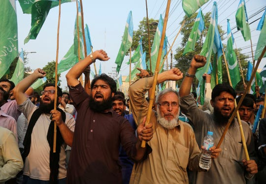 Supporters of the Pakistani religious party Jamaat-e-Islami demonstrate to protest India's policy on Kashmir, in Lahore, Pakistan, Tuesday, Aug. 6, 2019. Pakistan President Arif Alvi convened his country's parliament to discuss India's surprise actions on Kashmir.