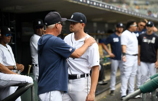 Tigers pitching coach Rick Anderson, left, talks with pitcher Tyler Alexander during his last start.