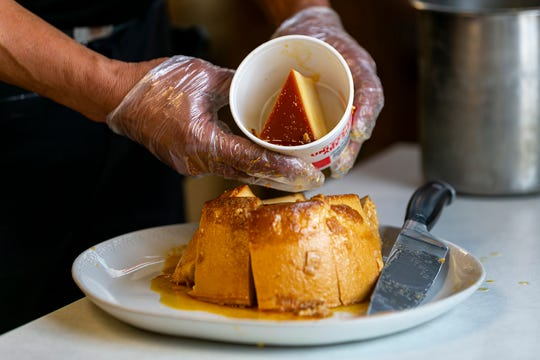 Flan is served at a Kentucky Fried Chicken in Hialeah, Fla. on Wednesday, July 24, 2019. During the 1960s, when KFC employed several recently arrived Cubans, a former restaurant sous chef from Cuba, Baldomero Gonzalez, made the flan as part of a staff meal. The original chef has died, but he passed the recipe on.