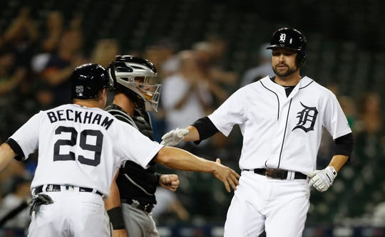 Detroit Tigers' Jordy Mercer, right, is congratulated by Gordon Beckham after they scored on Mercer's two-run home run during the seventh inning of Tuesday's 10-6 victory.