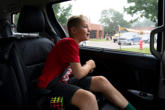 Eli Arrington, 9, spots a classmate as he rolls up on Cynthia Heights Elementary School on the first day of school Wednesday morning.
