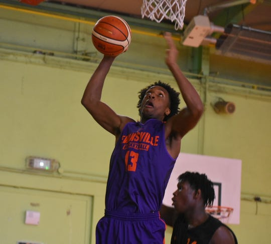 DeAndre Williams grabs a rebound Wednesday during the Purple Aces' third and final game in Europe
