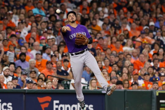 Colorado Rockies third baseman Nolan Arenado throws to first base during a game Tuesday night at Houston. The Rockies begin a four-game series in San Diego with an 8:10 p.m. game Thursday night.