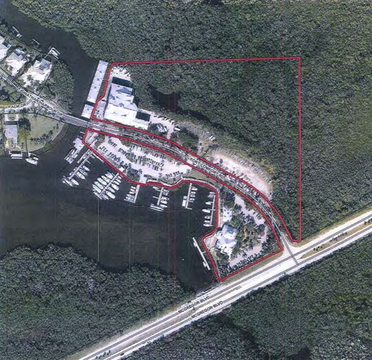 Residents of Connie Mack Island, shown offshore at top left, complained that a new boat storage facility at Port Sanibel Marina would make access to their million dollar homes more difficult due to boats being towed across Port Comfort Road by forklift.