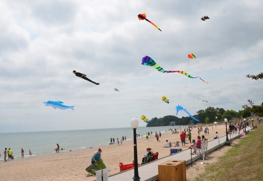 """Kites of all shapes and sizes fly over Crescent Beach in Algoma during the 2018 Soar on the Shore festival. This year's """"Soar on the Shore"""" is scheduled for Aug. 17."""