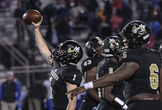 TL Hanna senior Alex Meredith (1) raises the ball after the last play of the fourth quarter of the Class AAAAA state playoffs at TL Hanna High School in Anderson on Friday, November 30, 2018. Hanna beat Byrnes 57-28 and advances to play Dutch Fork next Saturday.