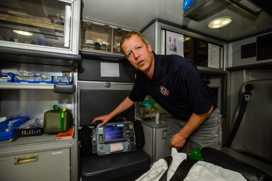 Justin Grohs of Great Falls Emergency Services talks about the portable EKG heart and blood pressure monitor carried on its ambulances. Great Falls Emergency Services will begin providing patient assessments and healthcare navigation assistance for the homeless through Saint Ann's Cathedral.