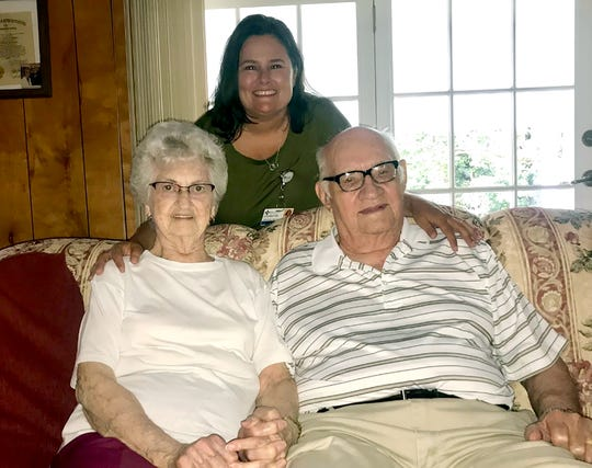 Crystal Buchanan, APRN (standing), visits Geneva and Cleatis Rodgers inside their home in Dixon, KY.