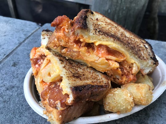 Two slices of American cheese, creamy macaroni and cheese and deep-fried nuggets of spicy Buffalo chicken breast bites fill this grilled cheese sandwich with potato tots. It's on the list of the best Indiana State Fair 2019 foods. Find the sandwich at The Lemonade Shoppe run by Freund Family Foods, across from the fair's Department of Natural Resources complex.