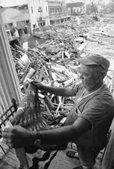 Pass Christian Civil Defense Director Parnell McKay looks over the town's main business district on August 23, 1969 after hurricane Camille passed through. (AP Photo/Jack Thornell)