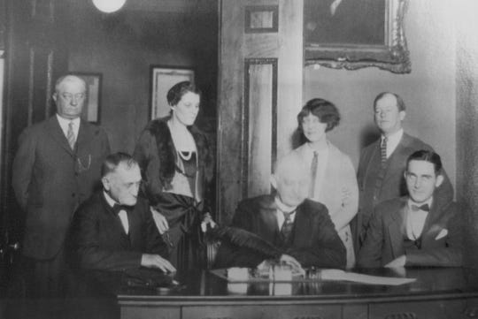 In a photograph from the Great Smoky Mountains National Park's new website that celebrates it's 75th anniversary, Tennessee Governor Austin Peay signs a contract purchasing 76,507 acres owned by the Little River Logging Company in 1926.  This will be the first land purchased for inclusion in the park area.