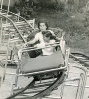 Carol Jean Bracken and Nancy Lou Bracken ride the roller coaster at the 1959 Tennessee Valley Fair.
