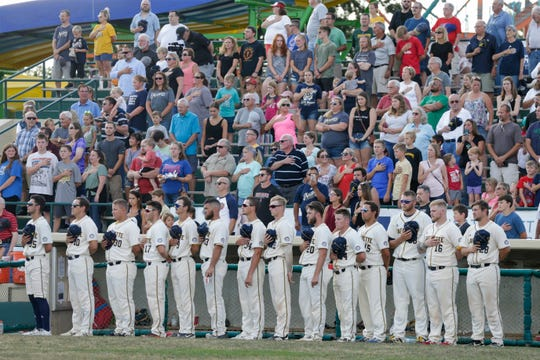 The Lafayette Aviators dugout stands during the national anthem before the last aviators game, Tuesday, Aug. 6, 2019 at Loeb Stadium in Lafayette.