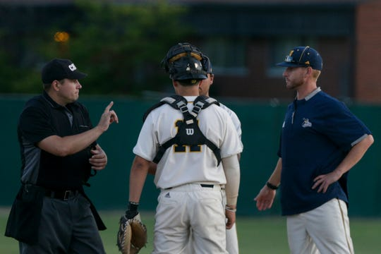 Umpire Tim Clark reminds Lafayette Aviators manager Brent McNeil of the time during the fifth inning of a prospect league baseball game, Tuesday, Aug. 6, 2019 at Loeb Stadium in Lafayette. The Champion City Kings won, 12-11 in 10 innings.