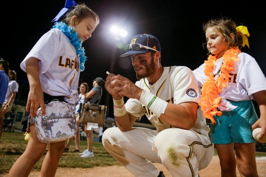 Lafayette Aviators right fielder Mason Sykes (22) signs autographs after the final game at Loeb Stadium, Tuesday, Aug. 6, 2019 in Lafayette.