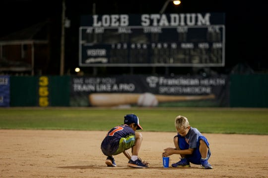 Camron Sell, 10, left and Colton Perry, 8, collect some infield dirt after the final game at Loeb Stadium, Tuesday, Aug. 6, 2019 in Lafayette.
