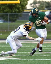 Jonah Schrock (25) was Howell's leading rusher last season.
