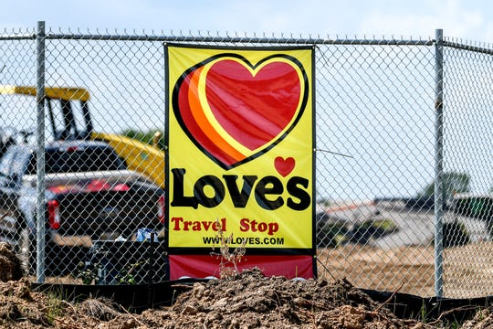 A sign for a Love's Travel Stop that is under construction photographed on Tuesday, Aug. 7, 2019, in Waterton Township. The new truck stop at the northwest corner of the intersection of Francis Road and W. Grand River Highway is near a Pilot Flying J Travel Center.