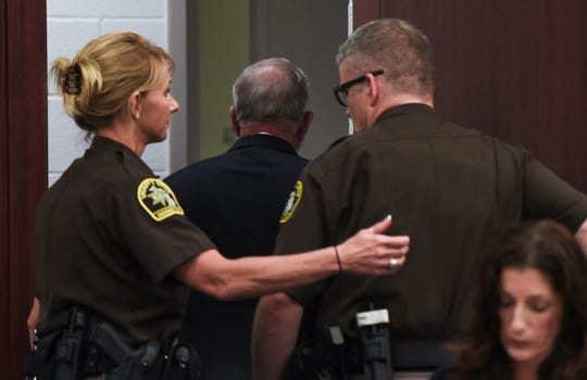 William Strampel, former dean at the College of Osteopathic Medicine at Michigan State University, is taken into custody Wednesday, Aug. 7, 2019, after being sentenced in Ingham County Circuit Court Judge Joyce Draganchuk's courtroom.