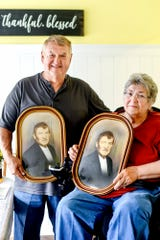 Ken Stone, left, holds a photograph of his grandfather and his sister Patricia Miller, right, holds the same photograph that Stone found recently while browsing The Mega Mall, an antiques and collectibles market. The two are photographed on Tuesday, Aug. 6, 2019, at Stone's home in DeWitt.