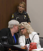 Former MSU gymnastics coach Kathie Klages talks with a member of her defense team Wednesday, Aug. 7, 2019, in Ingham County Circuit Court Judge Joyce Draganchuk's courtroom