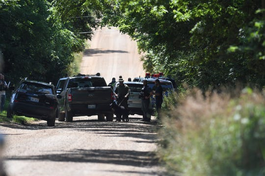 Michigan State Police and other agencies search for a man near the corner of Smith and Bunker Roads in Eaton Rapids, Wednesday, Aug. 7, 2019.