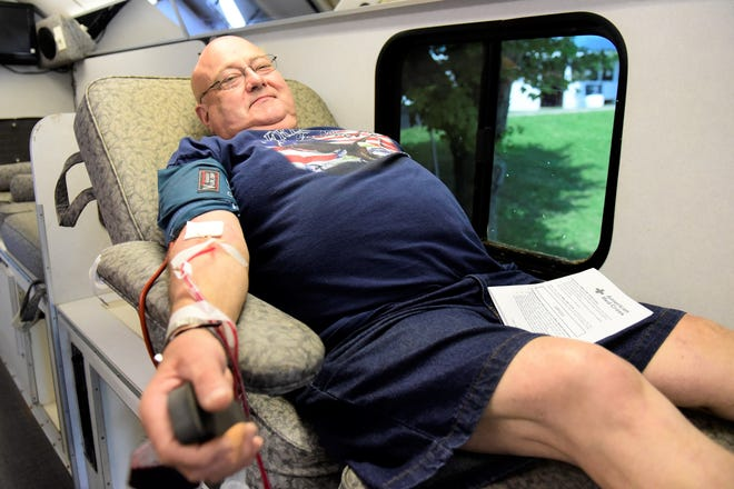 Steve Davis, of Mansfield, donates blood to the Red Cross during a recent blood drive. The organization is experiencing a severe shortage of blood in Ohio as surgeries resume post-pandemic.