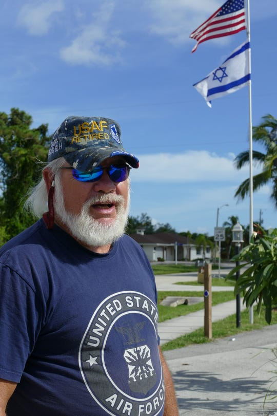 Brett J. Reynolds, an Air Force veteran, received a Code Enforcement violation notice about his sidewalk last September.