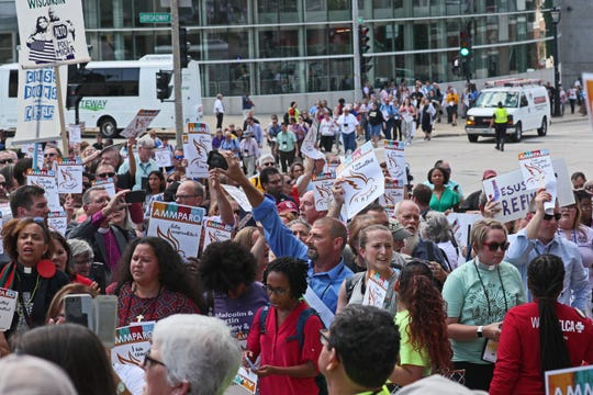 The Evangelical Lutheran Church in America hosted a prayer vigil to address the human rights of migrants entering the United States along the southern border in front of the ICE office at 310 E. Knapp St. in Milwaukee.  The vigil took place during the 2019 ELCA Churchwide Assembly meeting held this week in Milwaukee.