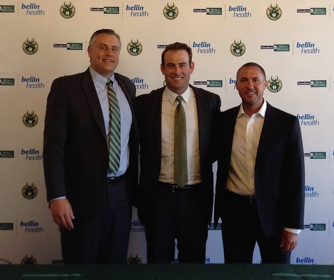 Chase Buford, center, the new head coach of the Wisconsin Herd, stands with team president Steve Brandes (left) and general manager Dave Dean.