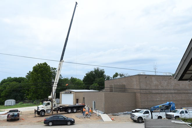 Construction continues Wednesday afternoon on the expansion to the Baxter County Detention Center. The Quorum Court on Tuesday night placed on its first reading an ordinance that would waive the $50-a-day fee charged to Baxter County cities for housing their inmates at the jail.