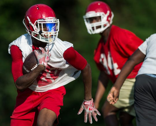 Running back Reggie Davis runs the ball during the first week of football practice for at Lee High School in Montgomery, Ala., on Tuesday, Aug. 6, 2019.