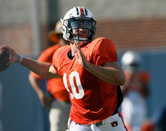 Auburn quarterback Bo Nix throws a pass during practice on Tuesday, Aug. 6, 2019 in Auburn, Ala.