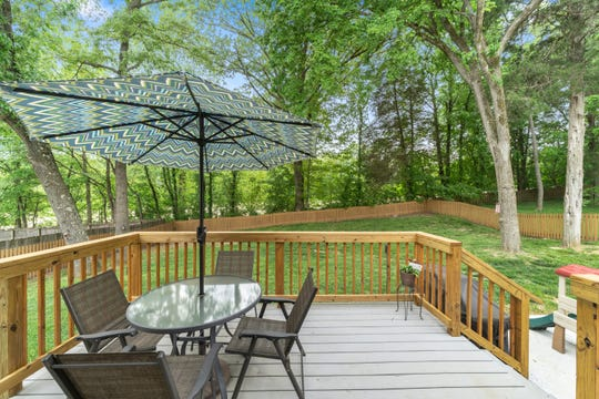 The backyard of Rebecca and Chris Winkler's new home is Clarksville is perfect for their sons to roam in and for entertaining.