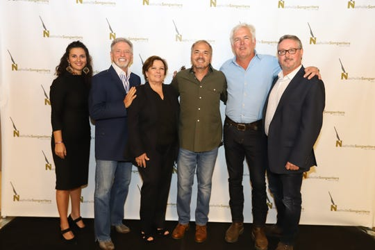 L-R: Nashville Songwriters Hall of Fame chair Sarah Cates with 2019 inductees Larry Gatlin, Sharon Vaughn, Marcus Hummon, Rivers Rutherford and Executive Director Mark Ford.
