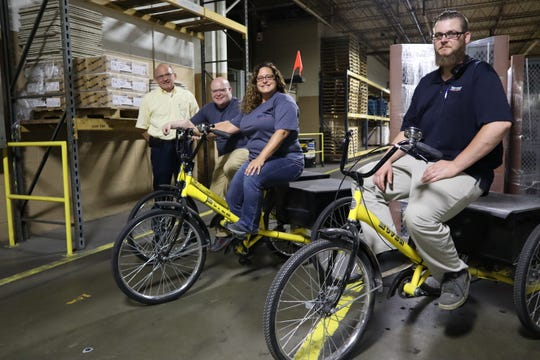 "Tennsco on the ""Power to Peddle"" bikes around the various Tennsco plants that allow employees to use their legs instead of fuel or energy to quickly move around the plants."