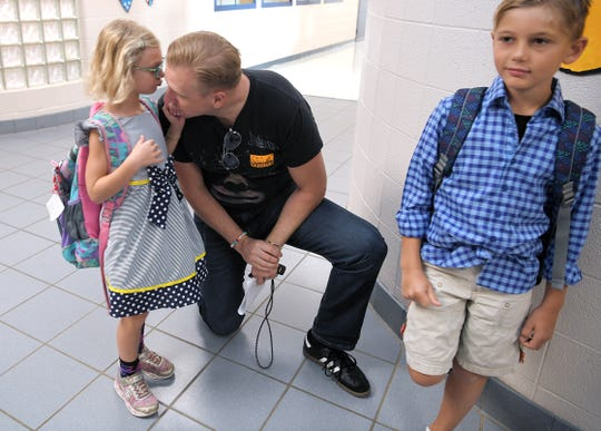 Brian Nilsen says goodbye to his children, Katie and Jackson, on the first day of school  at Franklin Elementary Schol on Wednesday, August 7, 2019.