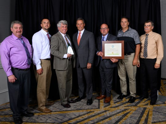 Pictured are Tennsco officials, including President Stuart Speyer, third from left, with Gov. Bill Lee, middle, at the Governor's Environmental Stewardship Awards Luncheon.